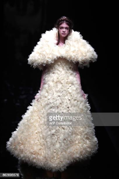 A model displays a creation from ELZA WINKLER designed by Eiichiro Nakai during the Amazon Fashion Week Tokyo 2018 spring/summer collection in Tokyo...