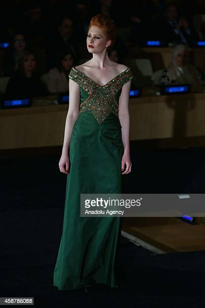 A model displays a creation from Palestinianborn Italian fashion designer Jamal Taslaq's FallWinter 20142015 collection within the framework of the...