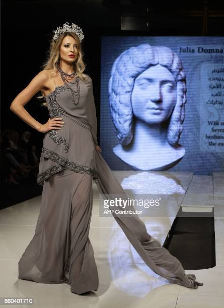A model displays a creation inspired by Julia Domna the wife of Roman Caesar Ceptimus and designed by Syrian Fashion Designer Manal Ajaj during her...