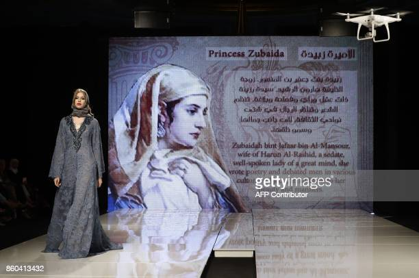 A model displays a creation inspired by Princess Zubaida the wife of the fifth Abbasid Caliph of Baghdad by Syrian fashion designer Manal Ajaj during...