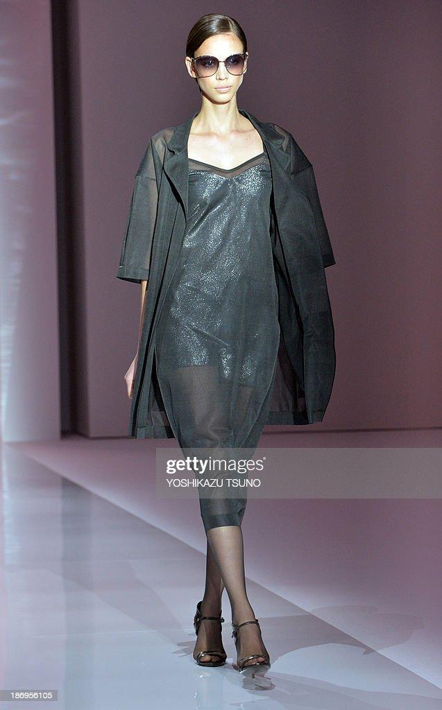 A model displays a creation of Italian fashion brand Max Mara collection in Tokyo on November 5, 2013. Max Mara is celebrating the 60th anniversary of its establishment. AFP PHOTO / Yoshikazu TSUNO