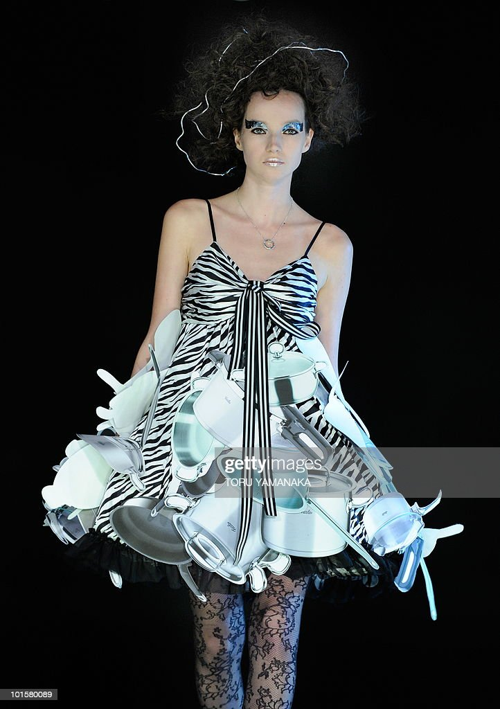 A model displays a creation of Japanese fashion brand Gut's Dynamite Cabarets during a fashion show held by German kitchenware maker Fissler in Tokyo on June 2, 2010. AFP PHOTO/Toru YAMANAKA