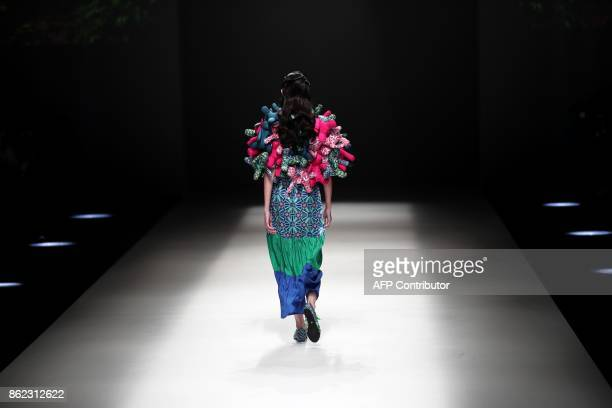 A model displays a creation of Loom Loop from Hong Kong designed by Polly Ho during the Amazon Fashion Week Tokyo 2018 spring/summer collection in...
