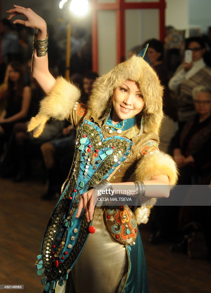 A model displays a creation of the ' Elements' collection by designers of the Hylyukai-Bashkirian Beauty' fashion theatre during the festival of Ethno Fashion 2013 in the Bolshoi Gostiny Dvor in St. Petersburg, on November 16, 2013.