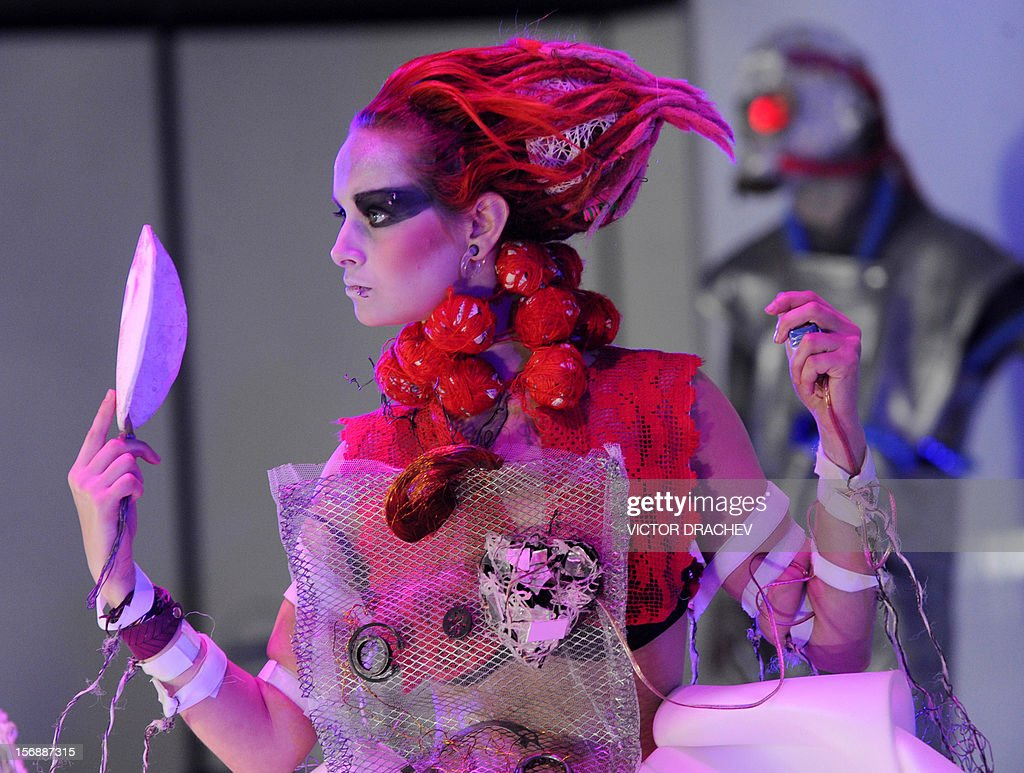 A model displays a creation of Vladimir Kustov on November 23, 2012 during the ART-2012 of Belarus exhibition of contemporary art in Minsk.