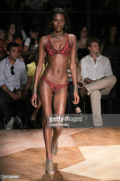 A model displays a design by Blue Man during the fourth day of Fashion Rio Summer 2011 collection at the Pier Maua on May 30 2010 in Rio de Janeiro...