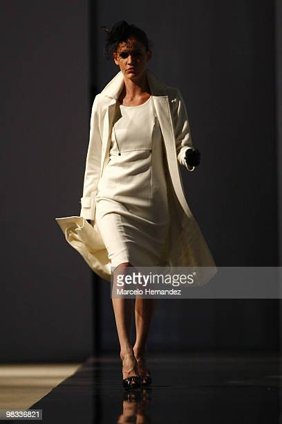 A model displays a design by Cecilia Bolocco for 'Apology' during a fashion show on April 8 2010 in Santiago Chile Bolocco is the designer of...