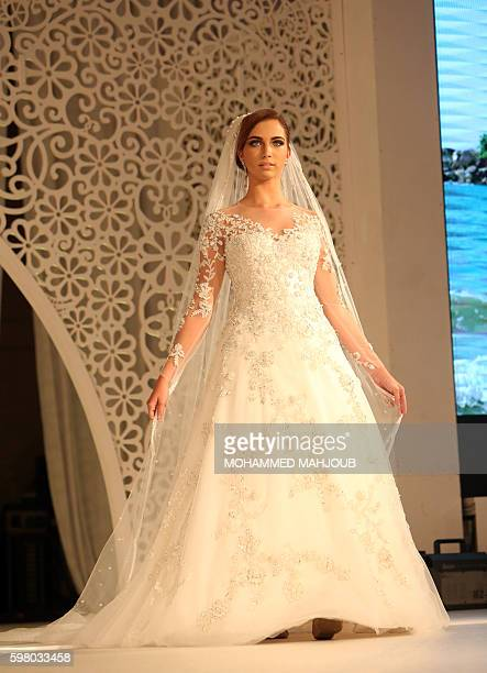 A model displays a dress created by Brazilian designer Lucas Anderi during the Omani Women's Fashion Trends event in the Omani capital Muscat on...