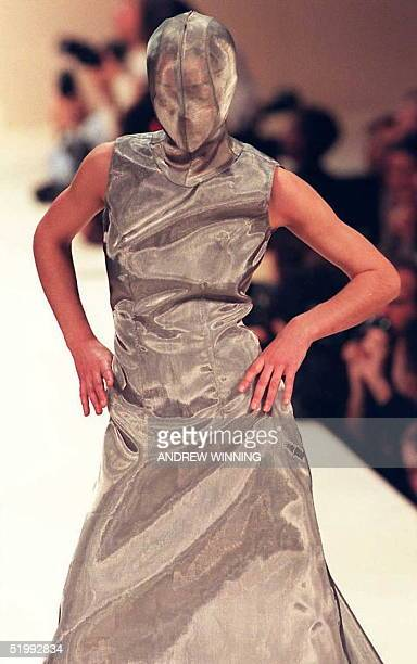 A model displays a hooded silvery dress from Alexander McQueen's summer collection on the fourth day of London fashion week 23 October AFP PHOTO