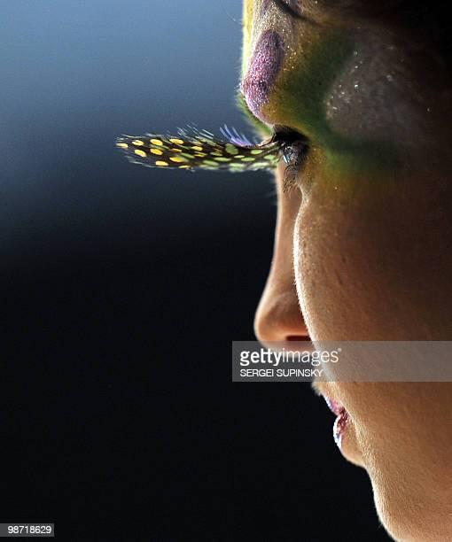 A model displays a makeup creation during the opening of IX International Festival of Hairdresser Art 'Cristal Angel' in Kiev on April 14 2010 AFP...