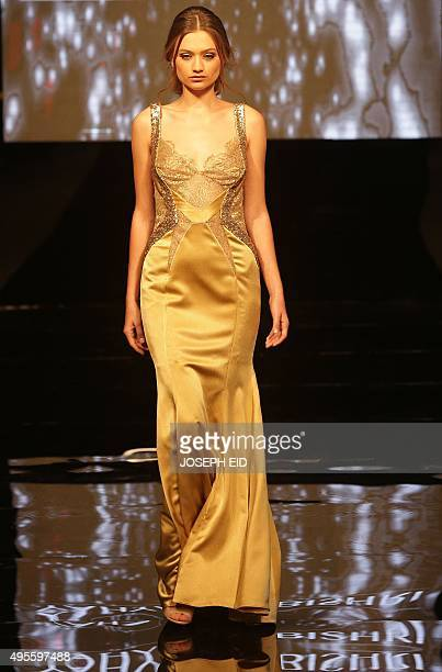 A model displays a new creation by Saudi fashion designer Yahya alBishri during the 'La Mode A Beyrouth' fashion week on November 4 2015 in the...