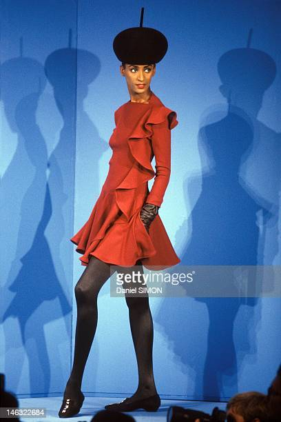 A model displays a Pierre Cardin's creation during the Haute Couture Fall Winter 1990/1991 Show on July 1990 in Paris France