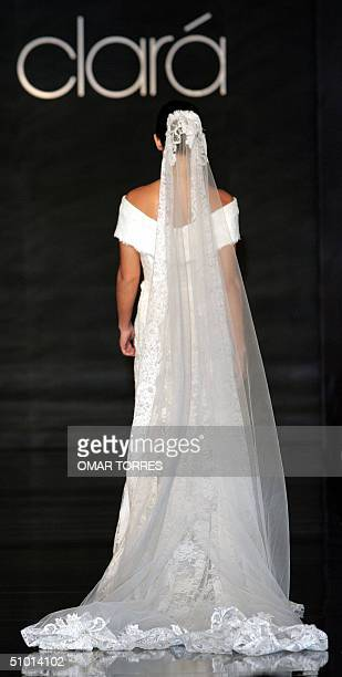A model displays a wedding dress by Spanish designer Rosa Clara as part of a show of Spanish designers in Mexico City 30 June 2004 AFP PHOTO/ Omar...