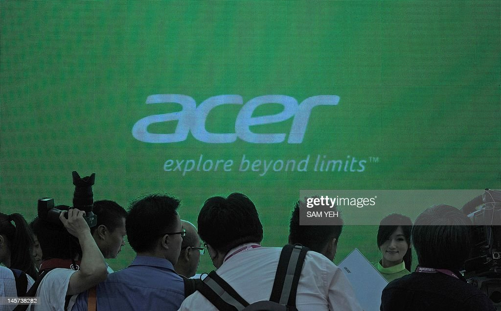 A model displays Acer products during the Computex 2012 in Taipei on June 5, 2012. Computex is Asia's leading IT trade fair. AFP PHOTO / Sam YEH