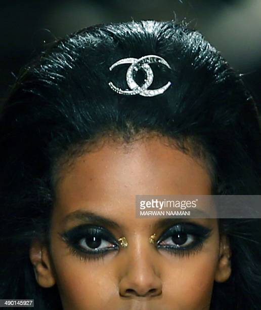 A model displays an accessory during the Chanel 2015 Cruise runway collection at The Island in Dubai a man made island in the shape of a palm tree on...