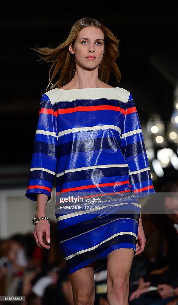 A model displays an outfit by designer Tommy Hilfiger during the Spring/Summer 2013 New York fashion week in New York on September 9, 2012. AFP PHOTO/Emmanuel Dunand