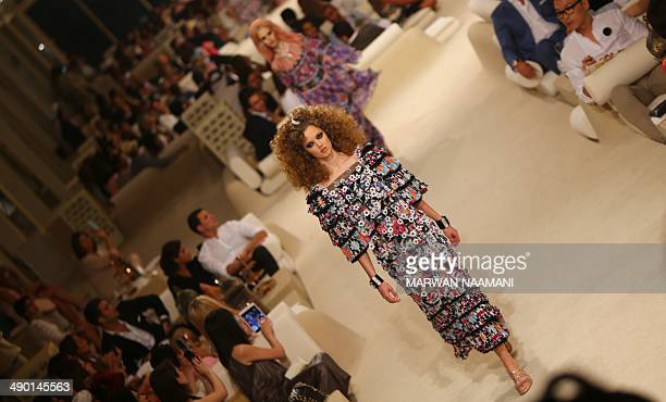 A model displays an outfit from the Chanel 2015 Cruise runway collection at The Island in Dubai a man made island in the shape of a palm tree on May...