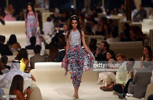 A model displays Chanel's 2014/2015 Cruise collection in the Emirati city of Dubai on May 13 2014 AFP PHOTO /MARWAN NAAMANI