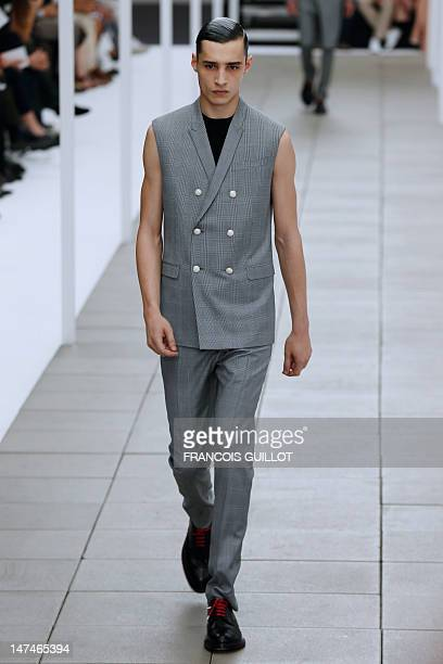 A model displays creations by Belgian designer Kris Van Assche for the label Dior during the men's springsummer 2013 fashion collection show on June...