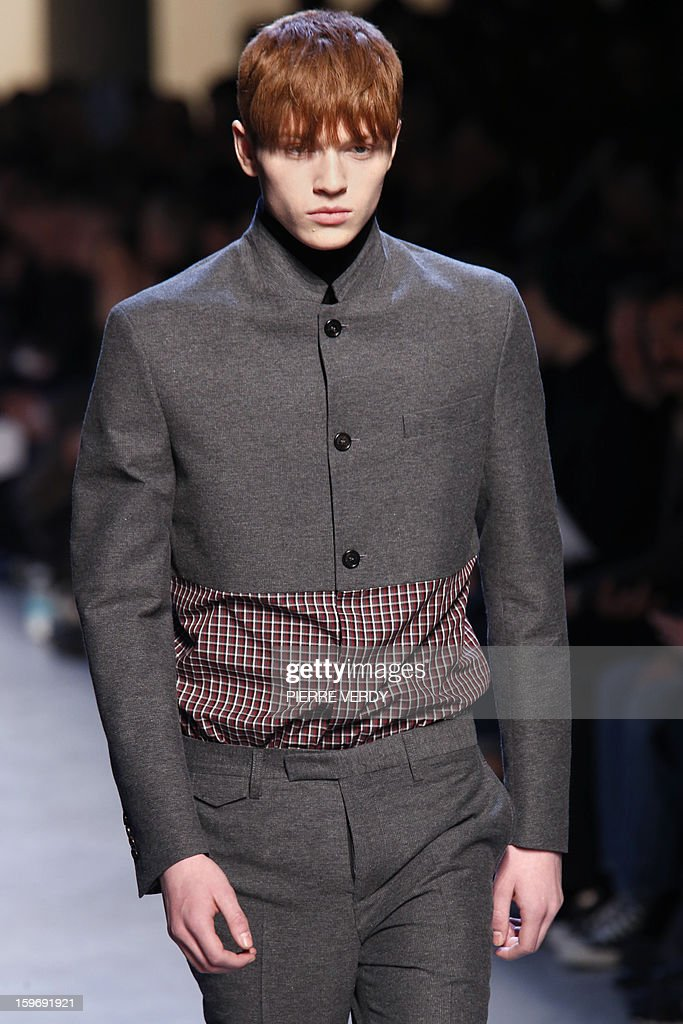 A model displays creations by Belgian designer Kris Van Assche on January 18, 2013 during his men's fall-winter 2013-2014 fashion collection show during the fashion week in Paris.