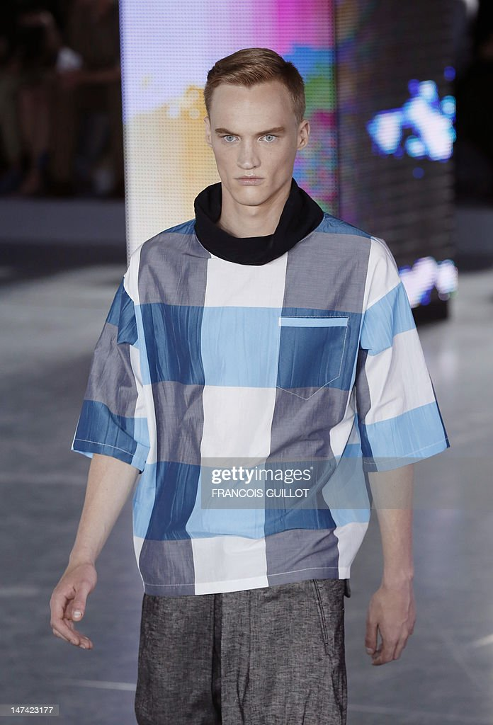 A model displays creations by British fashion designer Bill Gaytten for the label John Galliano fashion house during the men's spring-summer 2013 fashion collection show on June 29, 2012 in Paris.