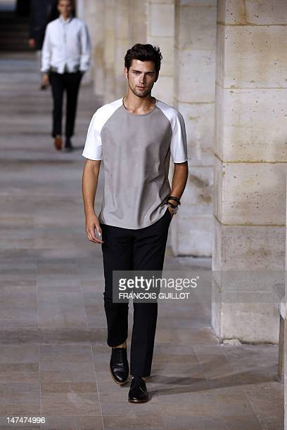 A model displays creations by French designer Veronique Nichanian for the label Hermes during the men's springsummer 2013 fashion collection show on...
