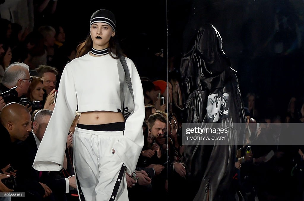 A model displays fashions during the Fenty PUMA by Rihanna show during the Fall 2016 New York Fashion Week in New York on February 12, 2016. / AFP / Timothy A. CLARY