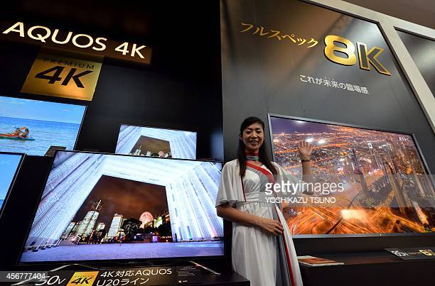 A model displays Japanese electronics giant Sharp's 4K and 8K television sets 8K television has 16 times higher resolution of current highdefinition...