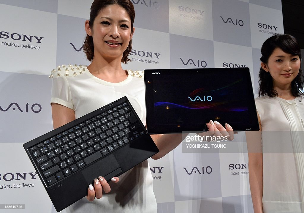 A model displays Japanese electronics giant Sony's new ultrabook computer 'Vaio Tap 11' which has 11-inch sized tablet with detachable keyboard in Tokyo on October 8, 2013. Sony will put it on the market on November 16. AFP PHOTO / Yoshikazu TSUNO
