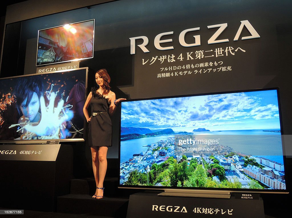 A model displays new Regza, four times more resolution than full HD, during their press conference on September 27, 2012 in Tokyo, Japan.