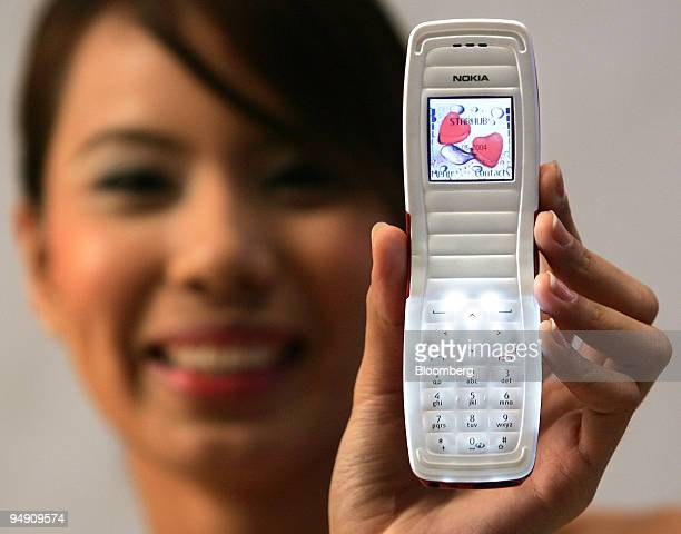 A model displays Nokia Oyj's newlyunveiled clamshell design 2650 phone in Singapore on Monday June 14 2004 Nokia Oyj the world's largest mobilephone...