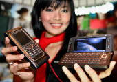 A model displays the new Nokia 'E90' mobile phone sets during a launching ceremony in Jakarta 13 June 2007 Nokia 'E90' communicator launched 13 June...