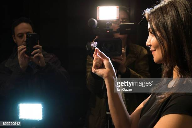 A model displays the 'Pink Star' diamond at Sotheby's on March 20 2017 in London England The Pink Star is the most valuable cut diamond ever to come...