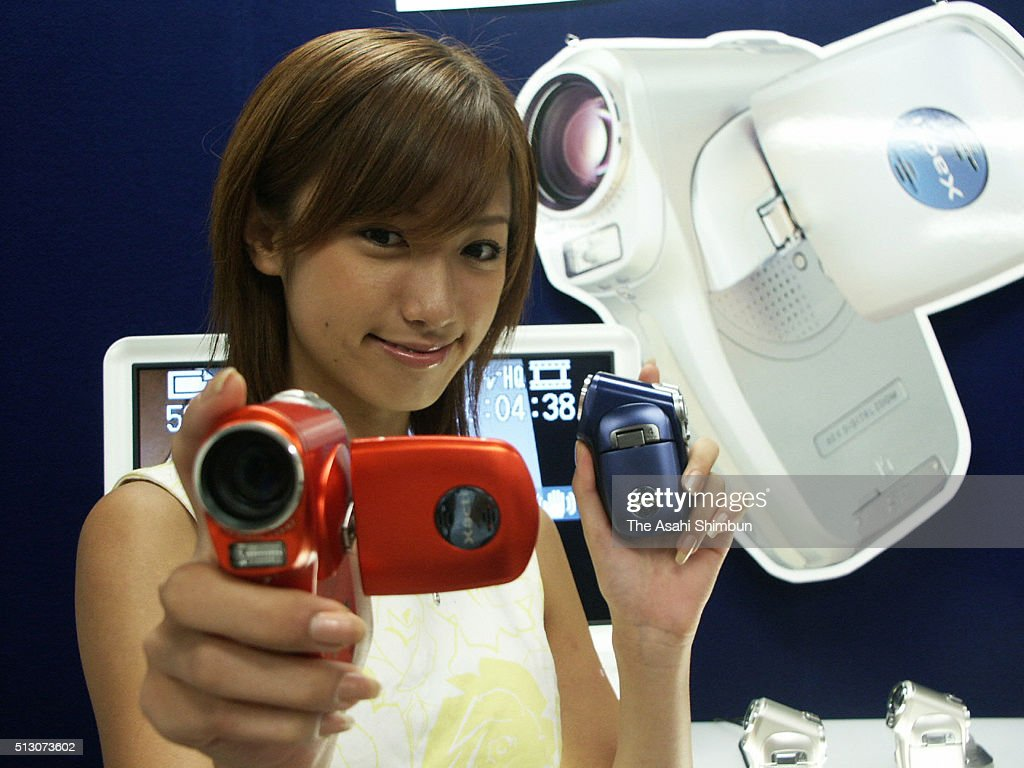 A model displays the Sanyo Electrics new digital camera recorder Xacti on August 23 2004 in Osaka Japan