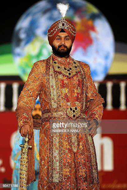 A model displays traditional Sikh wedding groom attire during the Mr Singh International 2009 Turban Pride Fashion Show in Amritsar late on November...
