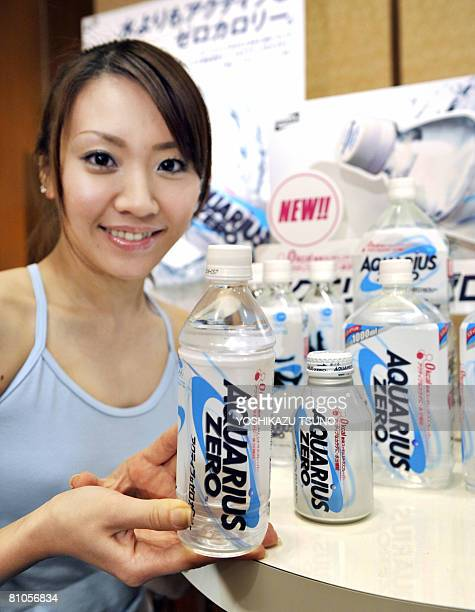 A model displays US beverage giant CocaCola's new sports drink 'Aquarius Zero' a no sugar and calorie free drink for calorie conscience athletes at a...