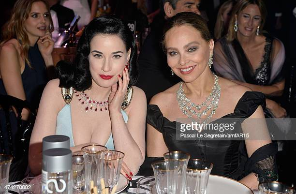 Model Dita Von Teese and Actress Ornella Muti attend amfAR's 22nd Cinema Against AIDS Gala Presented By Bold Films And Harry Winston at Hotel du...