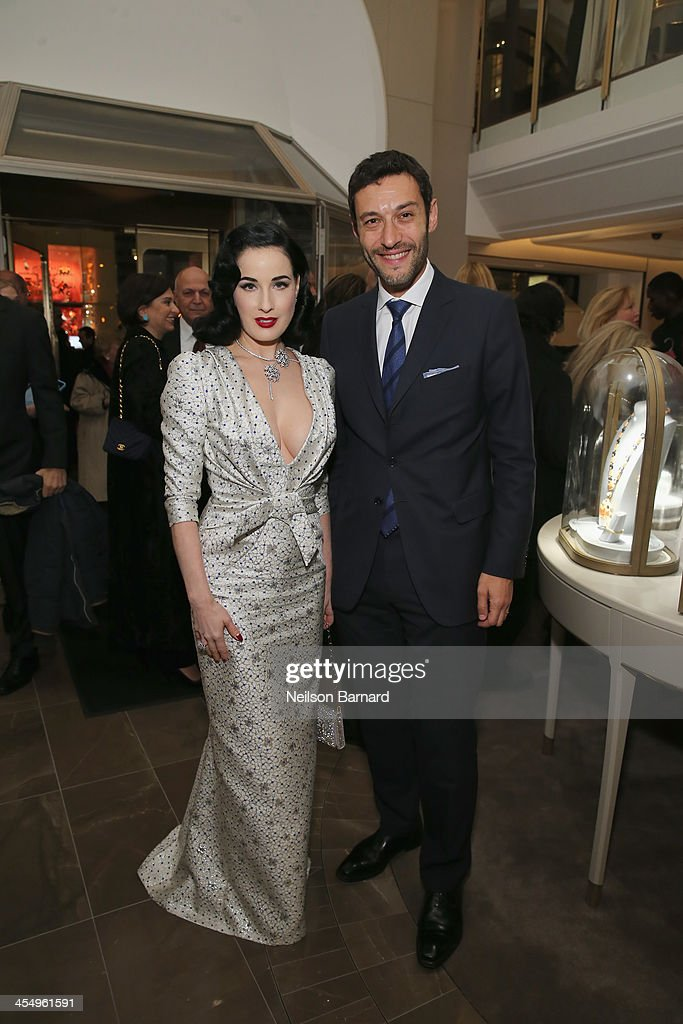 Model <a gi-track='captionPersonalityLinkClicked' href=/galleries/search?phrase=Dita+Von+Teese&family=editorial&specificpeople=210578 ng-click='$event.stopPropagation()'>Dita Von Teese</a> and CEO of Americas <a gi-track='captionPersonalityLinkClicked' href=/galleries/search?phrase=Alain+Bernard+-+Businessman&family=editorial&specificpeople=14084988 ng-click='$event.stopPropagation()'>Alain Bernard</a> attend the unveiling of Van Cleef & Arpels redesigned New York 5th Avenue Flagship Maison at Van Cleef & Arpels on December 10, 2013 in New York City.