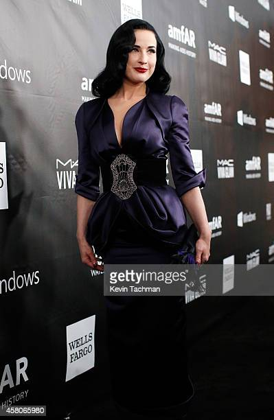 Model Dita Von Teese attends amfAR LA Inspiration Gala honoring Tom Ford at Milk Studios on October 29 2014 in Hollywood California