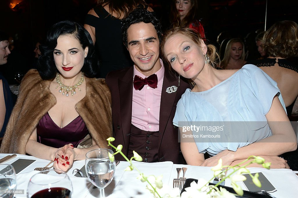 Model <a gi-track='captionPersonalityLinkClicked' href=/galleries/search?phrase=Dita+Von+Teese&family=editorial&specificpeople=210578 ng-click='$event.stopPropagation()'>Dita Von Teese</a>, designer Zac Posen and actress <a gi-track='captionPersonalityLinkClicked' href=/galleries/search?phrase=Uma+Thurman&family=editorial&specificpeople=171973 ng-click='$event.stopPropagation()'>Uma Thurman</a> attend MAC Cosmetic's John Demsey and Zac Posen's dinner to celebrate his Pre- Fall Collection at Mr Chow on December 11, 2013 in New York City.