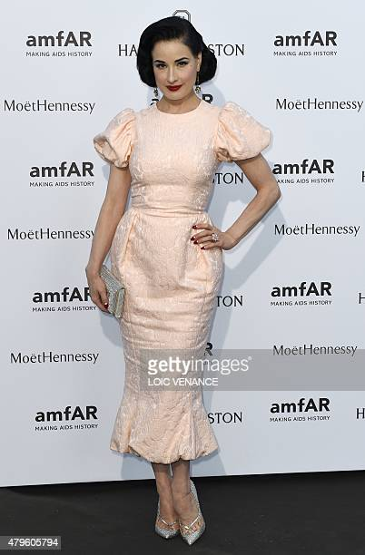 US model Dita von Teese poses prior to the Amfar dinner on the sidelines of the Paris fashion week on July 5 2015 in Paris AFP PHOTO / LOIC VENANCE