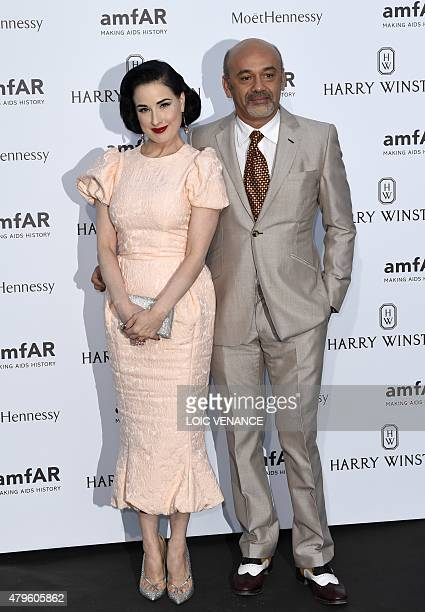 US model Dita von Teese poses with French shoe designer Christian Louboutin prior to the Amfar dinner on the sidelines of the Paris fashion week on...