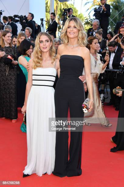 Model Dolores Doll and Alice Taglioni attend the 'Ismael's Ghosts ' screening and Opening Gala during the 70th annual Cannes Film Festival at Palais...