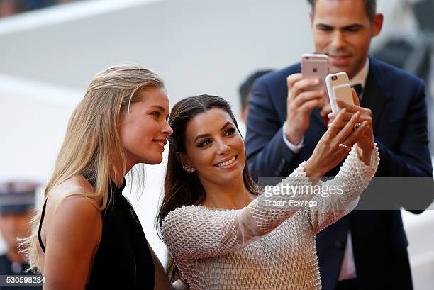 Model Doutzen Kroes and american actress Eva Longoria take a selfie at the 'Cafe Society' premiere and the Opening Night Gala during the 69th annual...