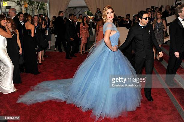 Model Doutzen Kroes and designer Zac Posen attend the Costume Institute Gala Benefit to celebrate the opening of the 'American Woman Fashioning a...