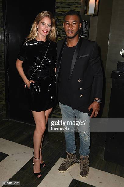 Model Doutzen Kroes and DJ Sunnery James attends the Balmain and Olivier Rousteing after the Met Gala Celebration on May 02 2016 in New York New York