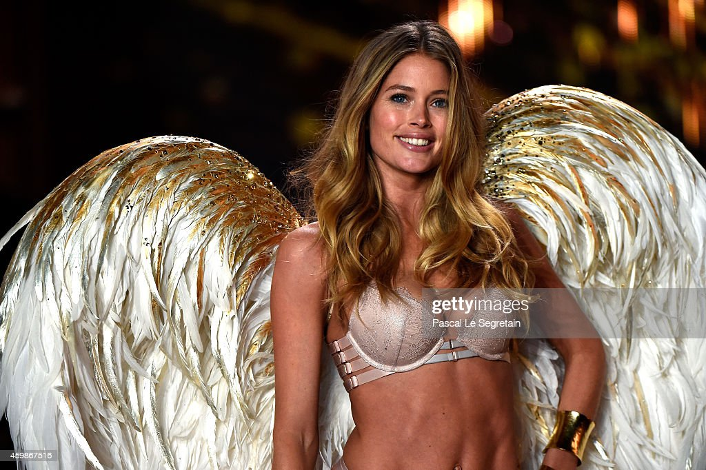 Model Doutzen Kroes walks the runway at the annual Victoria's Secret fashion show at Earls Court on December 2, 2014 in London, England.