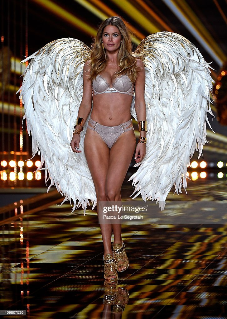 Model <a gi-track='captionPersonalityLinkClicked' href=/galleries/search?phrase=Doutzen+Kroes&family=editorial&specificpeople=859655 ng-click='$event.stopPropagation()'>Doutzen Kroes</a> walks the runway at the annual Victoria's Secret fashion show at Earls Court on December 2, 2014 in London, England.