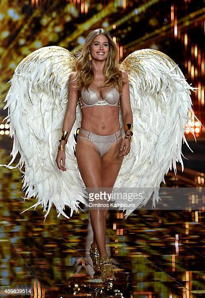 Model Doutzen Kroes walks the runway during the 2014 Victoria's Secret Fashion Show at Earl's Court Exhibition Centre on December 2 2014 in London...