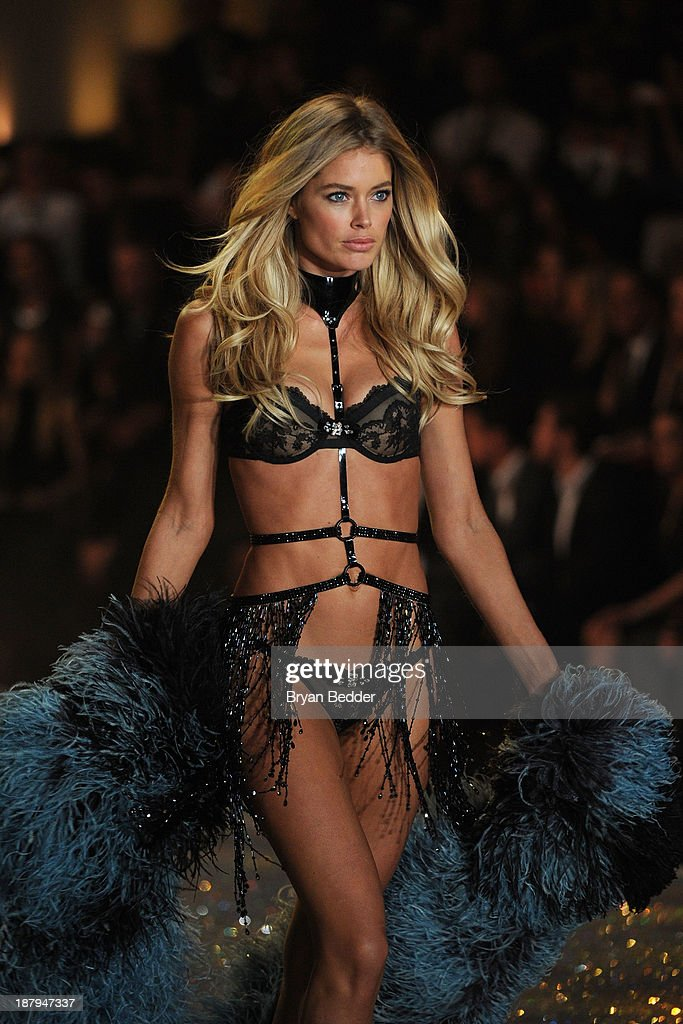 Model Doutzen Kroes walks the runway wearing Harness with Swarovski Crystals at the 2013 Victoria's Secret Fashion Show at Lexington Avenue Armory on November 13, 2013 in New York City.